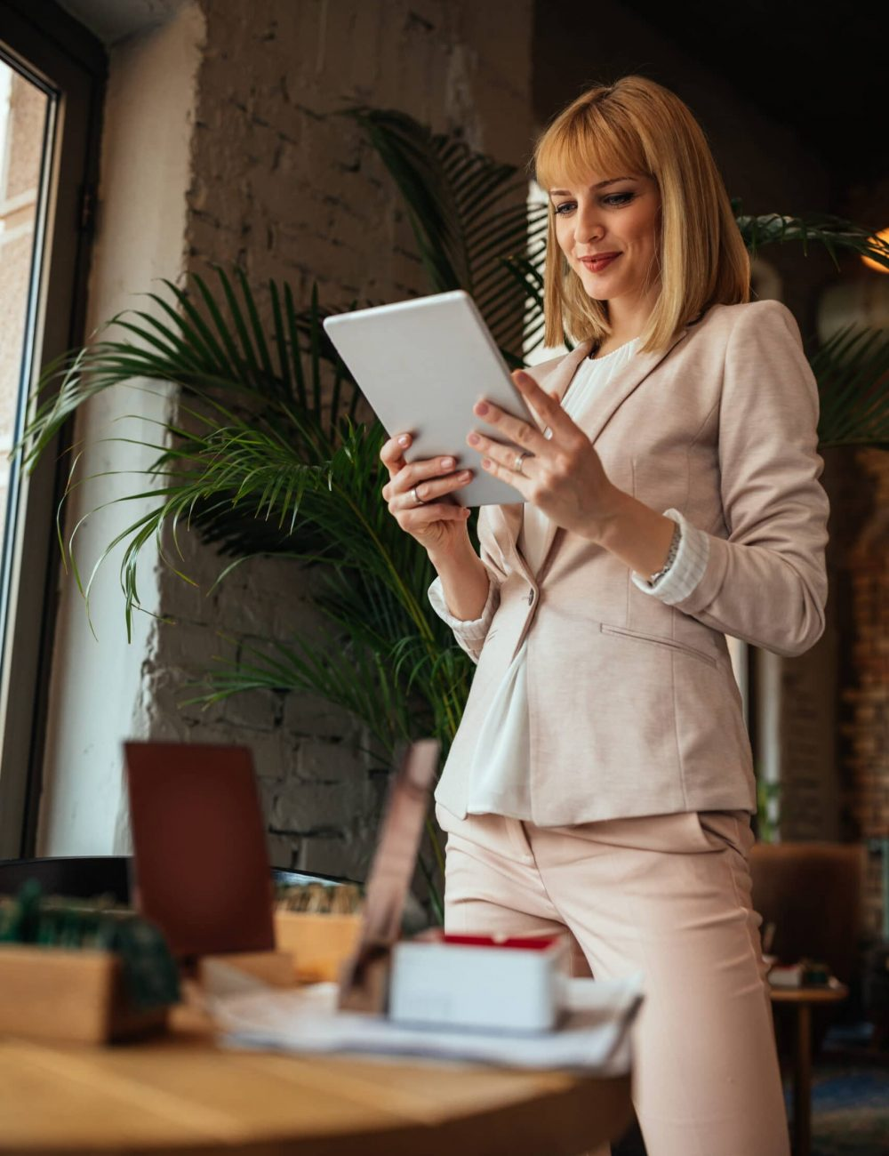 Shot of a young businesswoman using a digital tablet in a coffee shop